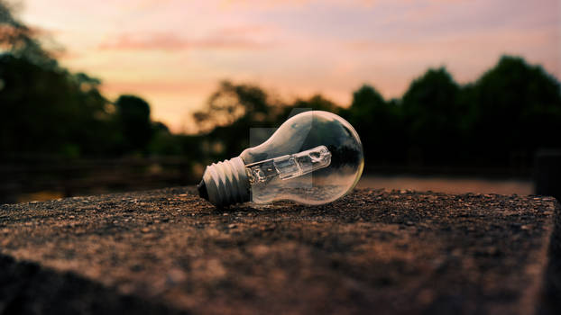 A glowing bulb in the dusk