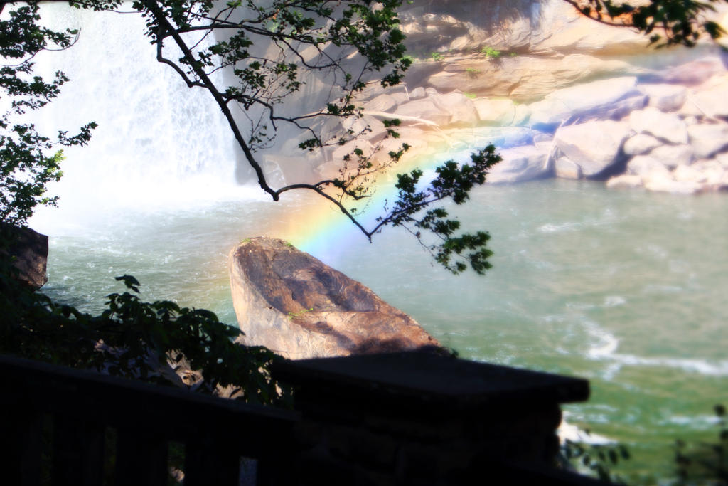 Rainbow at waterfall by Lucifeil