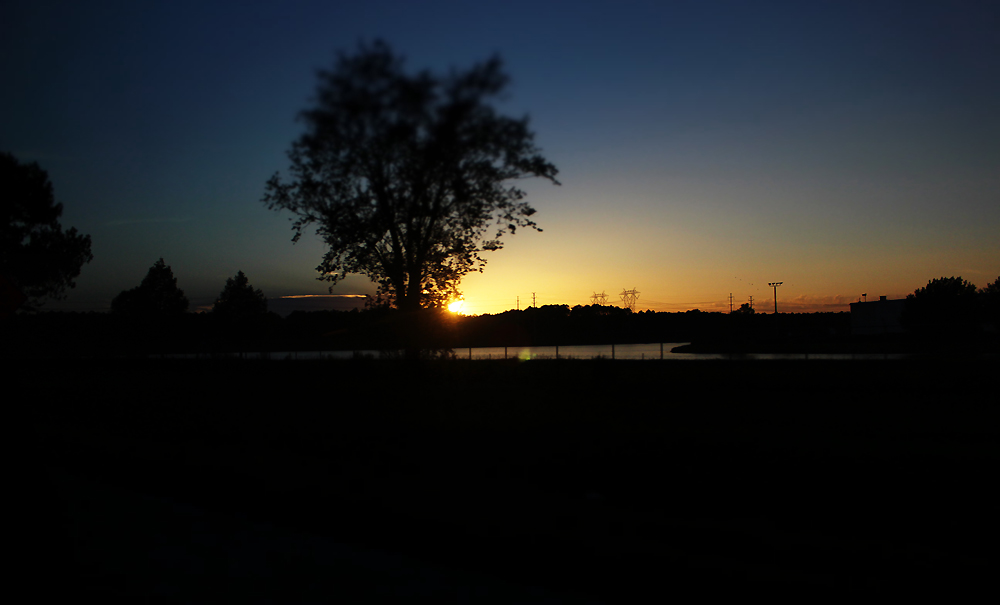 Sunset with tree in the way.. by Lucifeil