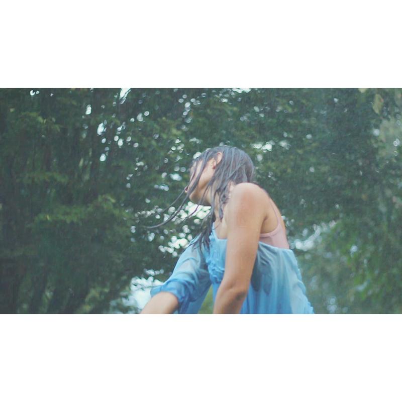 Dancing in the rain by NetherworldQueen