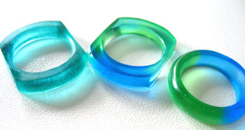 blue green stacking rings by TopazTurtle