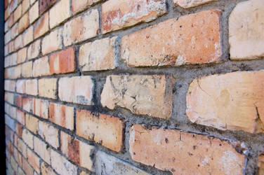 Long brick wall by wishez