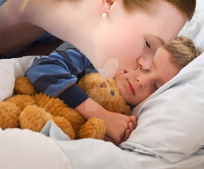 Mother kissing sleeping boy
