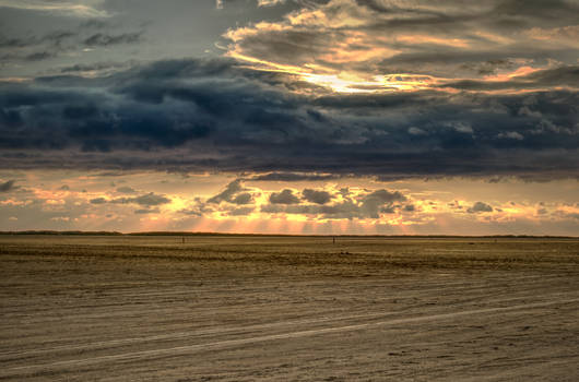 Sunraiys breaking through evening clouds