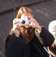 Behind a camera