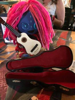 Layla plays a ukulele