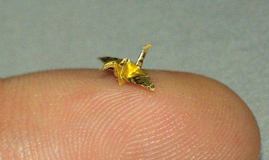 mini origami crane on finger by JSaken on DeviantArt - photo#2