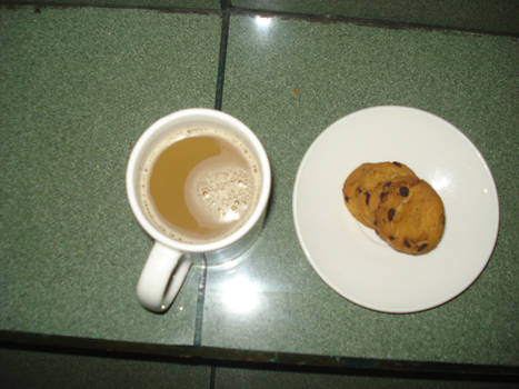 Choco chips cookies and a cup of white coffee