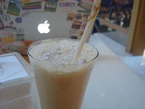 Iced cappucino and an laptop