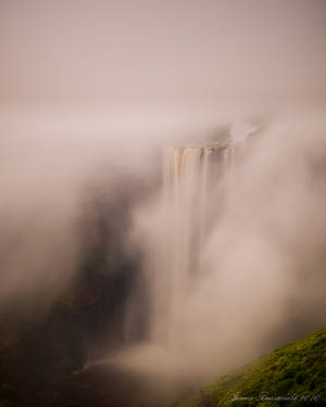 Water falls through mist