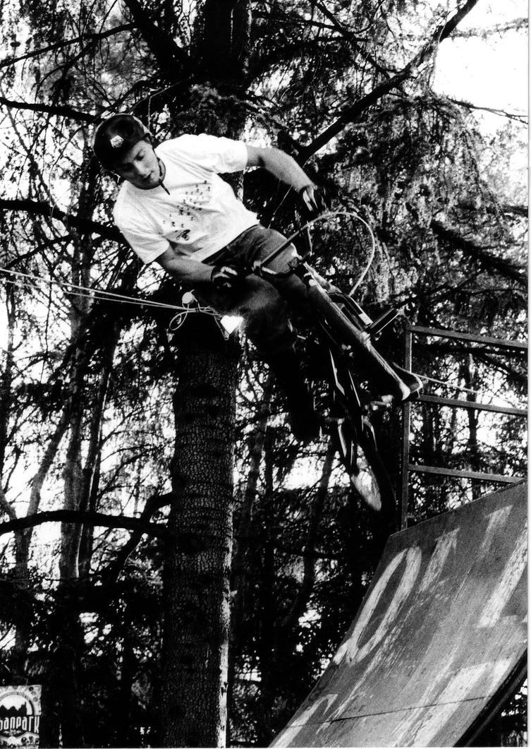 Black and white BMX on the half pipe by rotellaro