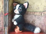 Grumpy cat in bunny slippers
