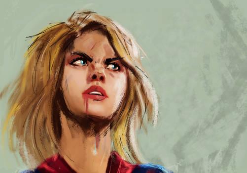 Supergirl combate.