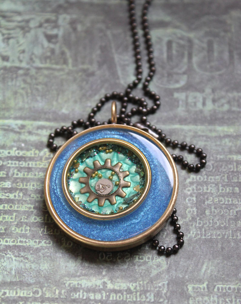 Blue and green round necklace by sillysarasue