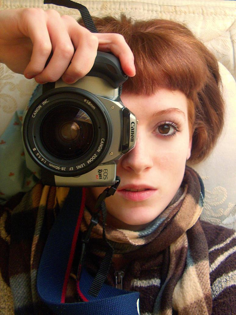 Girl with the camera  by NikxStock - Avatar Bulmaca