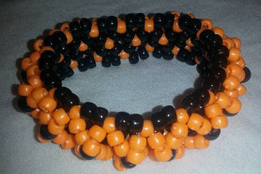 Orange and black kandi cuff bracelet by ManiacalRemedies