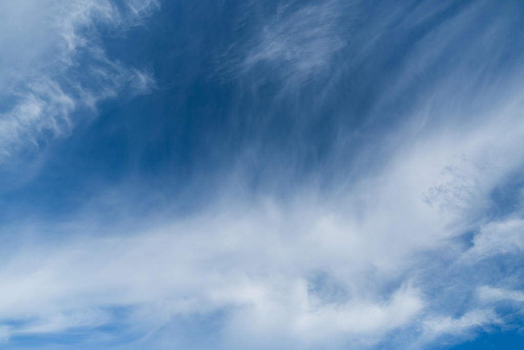 Blue Sky with Fuzzy Clouds by prionkor
