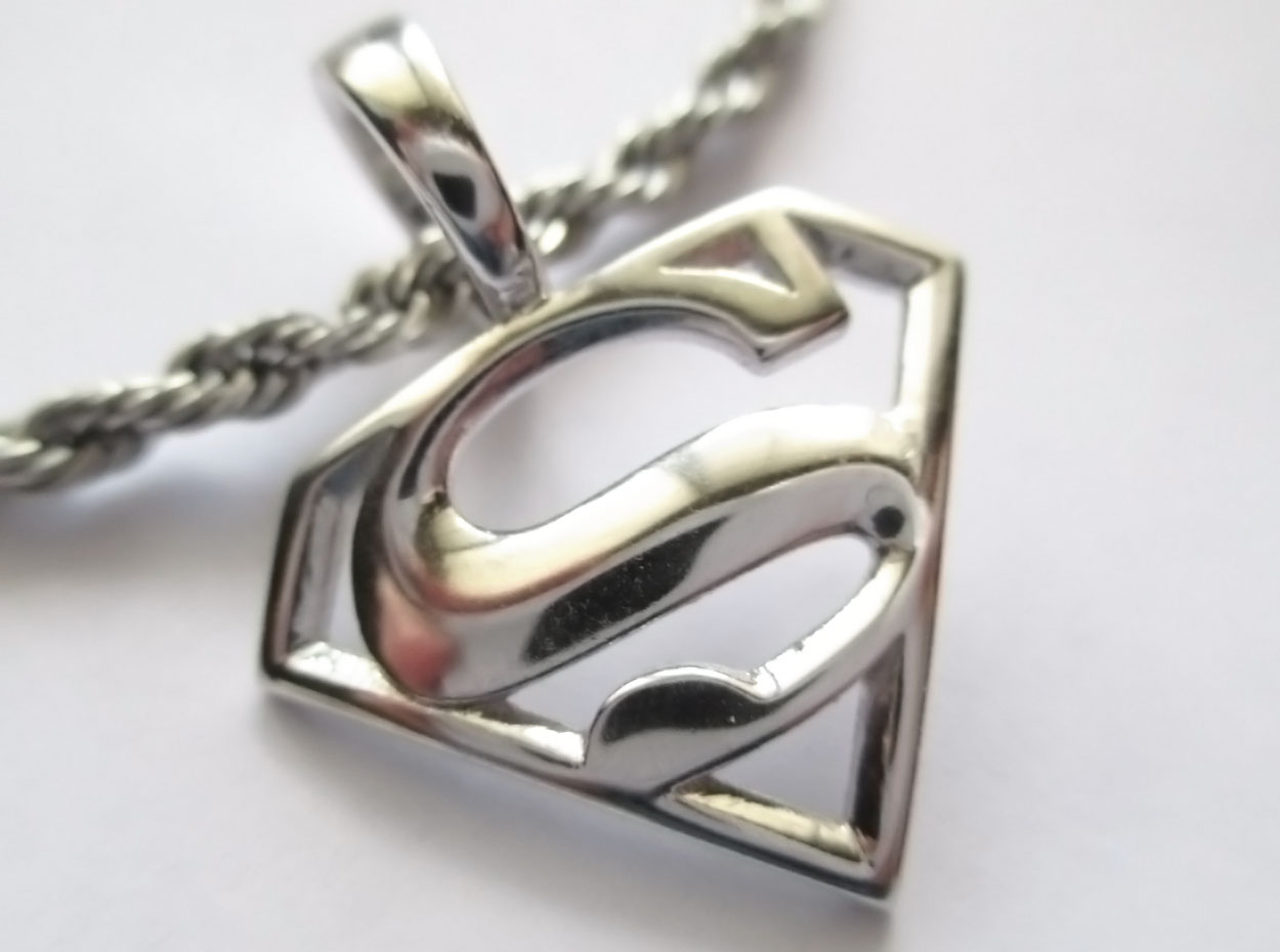 superman charm pendant by jeremymallin on deviantart