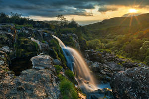 Loup of Fintry Sunset Waterfall by boldfrontiers