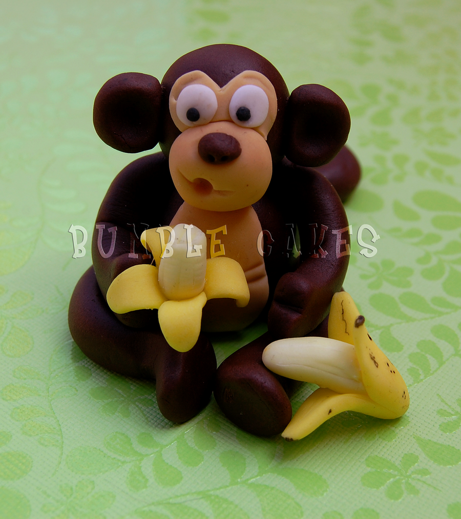 Monkey with his banana by Vixxybo
