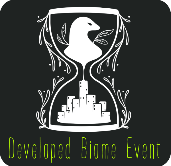 The Developed Biome Event badge. It's got a bust of an esk, captured inside an hourglass with rising buildings on the reverse.