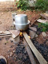 Cooking in native Uganda by nemesisfixx