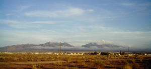 Clouds Below the Hualapai Mtns by vashsunglasses