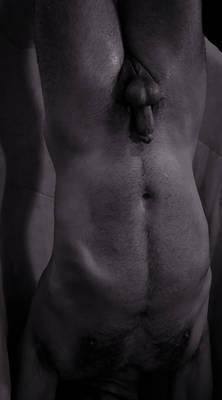 male nude in bondage hanging upside down