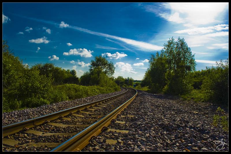 http://fc02.deviantart.com/fs18/f/2007/163/0/0/Train_track_into_the_horizon_by_DarkShadow_Ay.jpg