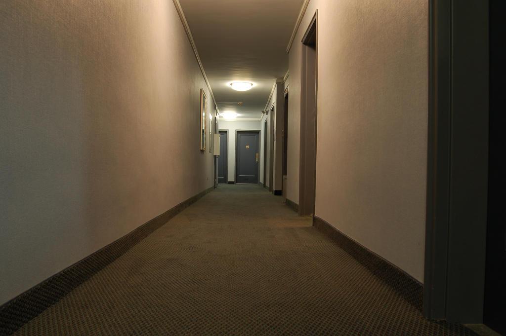 Dark Hallway with Doors by happeningstock