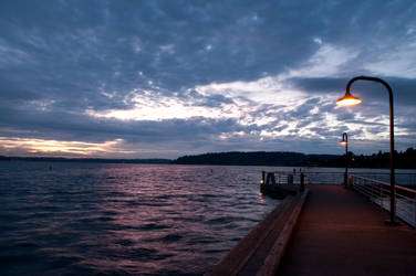Dark Pier after Sunset with Lampposts