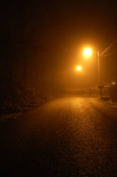 Fog on Street with Streetlamp by happeningstock