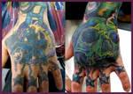 skull hand coverup tattoo