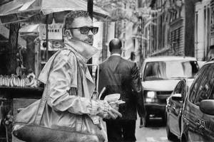 Man in sunglasses with coffee and bag