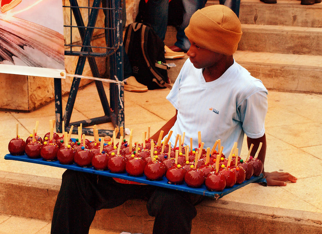 Candy apple seller by Lord-LestatDlaCuadra
