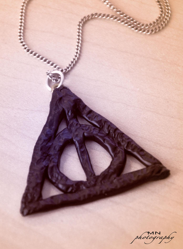 The symbol of the deathly hallows by kattvalk on deviantart the symbol of the deathly hallows by kattvalk biocorpaavc Images