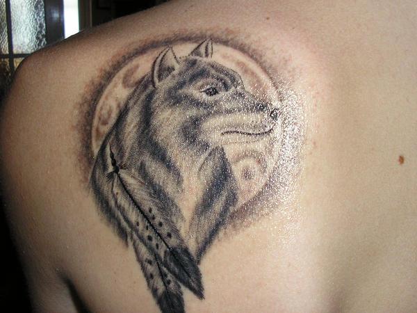 tribal wolf paw. wolf tattoos. tribal wolf