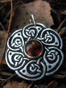 Silver pendant filled with balck enamel