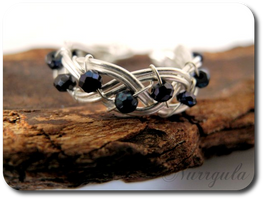 Silver braid ring with mystic Topaz by nurrgula