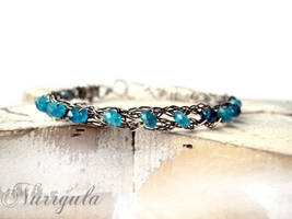 Silver braided bracelet wit teal Apatite gemstones by nurrgula