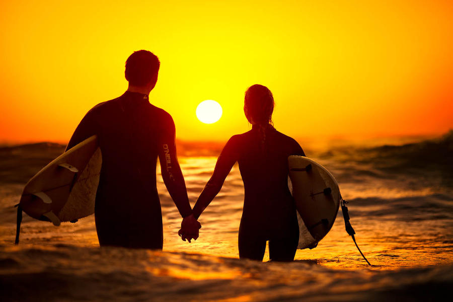 Two surfers... by JunKarlo
