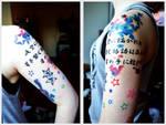 LM.C tattoo arm