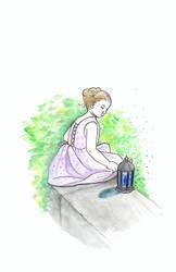 Girl + lantern on a small wall