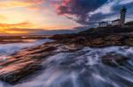 Beaver Tail Lighthouse at sundown