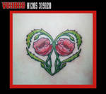 flower heart tattoo