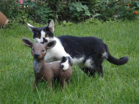 Cat with little deer statue
