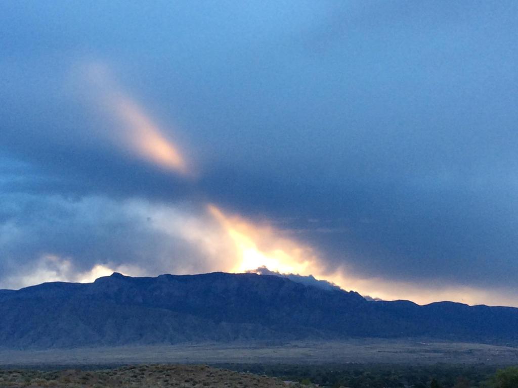 ImageSunrise over the Sandia Mt. by samtuya