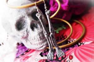 Silver Glitter Skeleton Leg Bone Earrings by Cateaclysmic