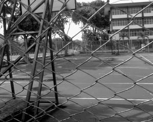 behind chained fences...