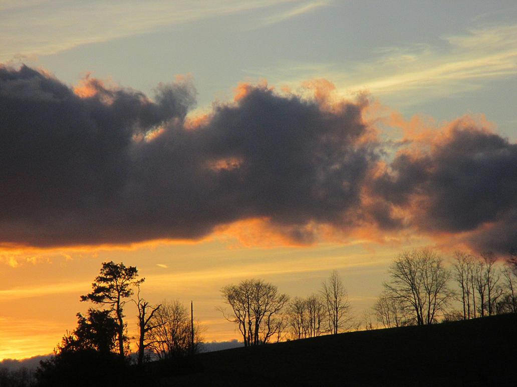 clouds over the hill by sunbeamfireking
